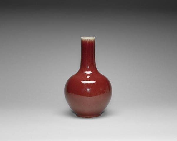 An 'ox-blood' glazed bottle vase, Qing Dynasty