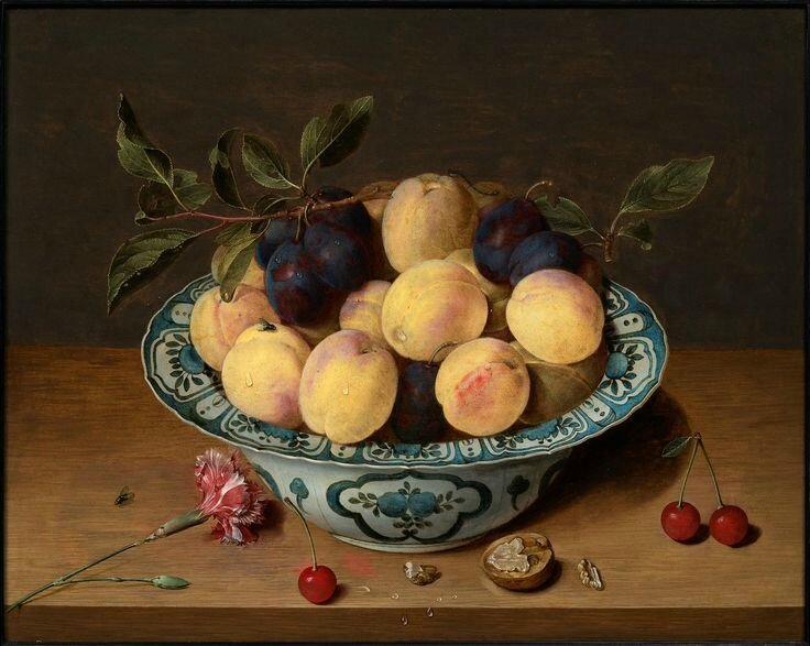 Isaac Soreau (Hanau 1604 - after 1638), A still life with peaches and plums in a dish.
