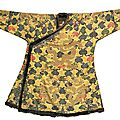 An imperial yellow satin brocade tibetan -style 'dragon' robe (chuba), qing dynasty, kangxi period