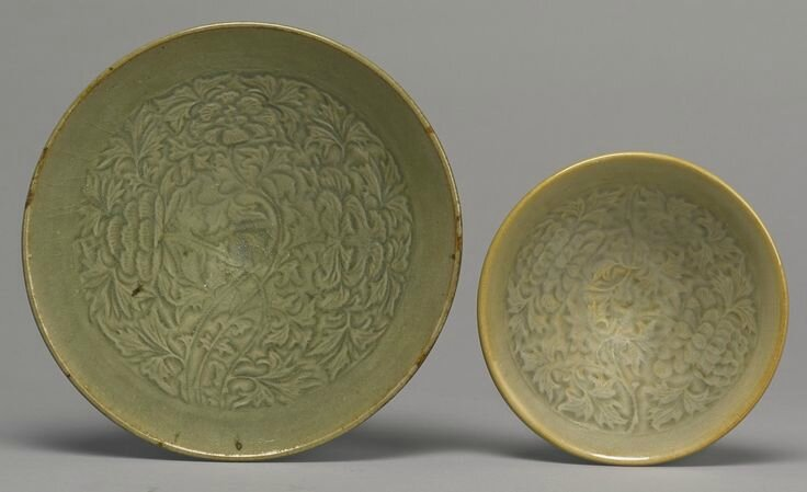 Two 'Yaozhou' molded 'Peony' bowls, Northern Song-Jin dynasty
