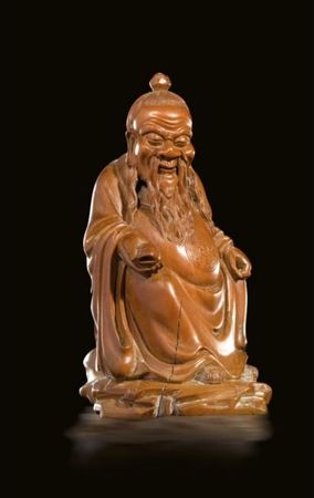 A_carved_boxwood_figure_of_a_seated_Daoist