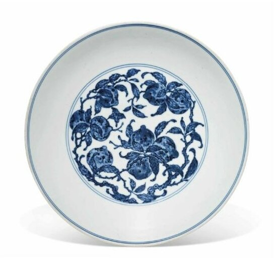 A blue and white 'Nine peaches' dish, Qianlong six-character seal mark in underglaze blue and of the period (1736-1795)