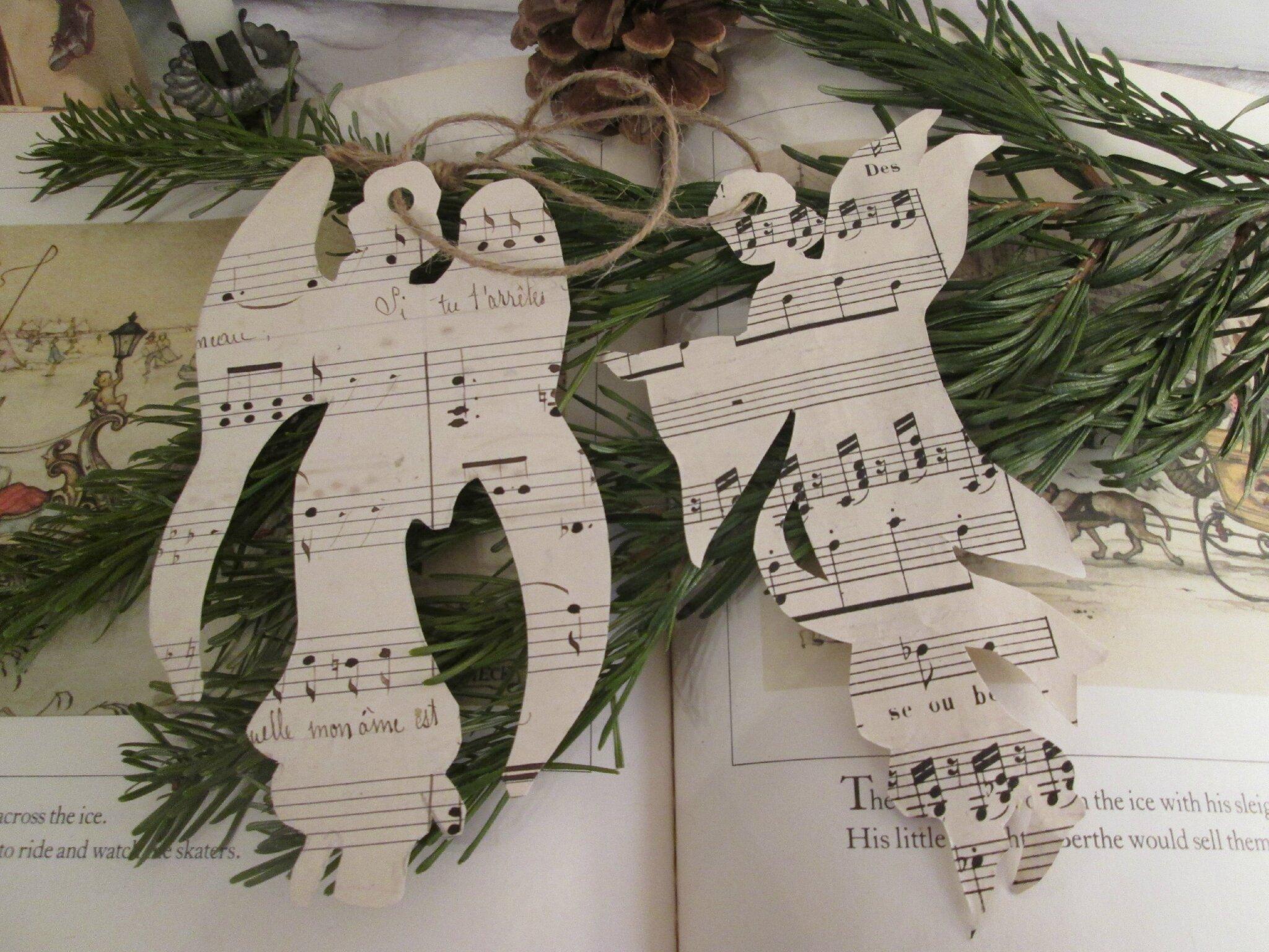 Anges en papier à musique à suspendre