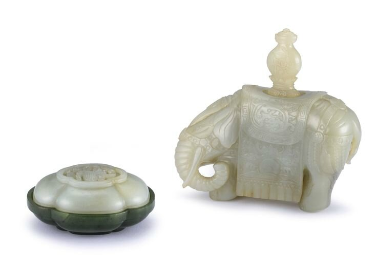 A pale celadon jade elephant and a spinach-green and celadon jade box and cover, Qing dynasty, 19th century
