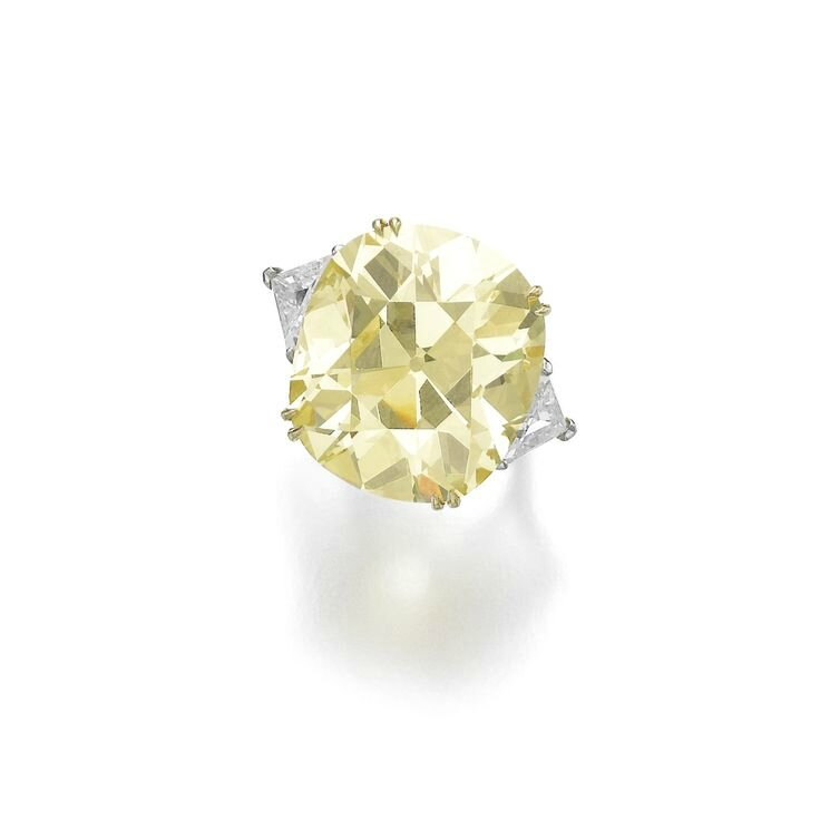 Impressive fancy yellow diamond ring