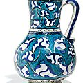 An iznik polychrome pottery jug with palmettes, turkey, circa 1580