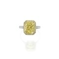 Platinum, 18 karat gold, fancy intense yellow diamond, colored diamond and diamond ring