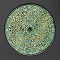 A magnificent bronze mirror with turquoise and gold inlays, Eastern Zhou dynasty, Warring States