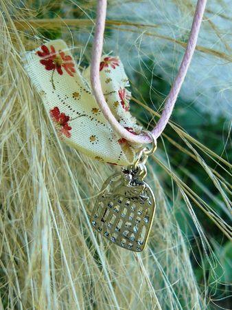 collier Aux Petites Canailles cage oiseau