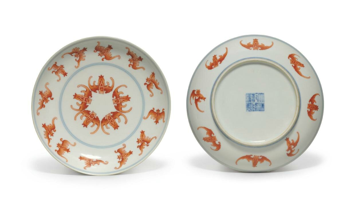 A pair of iron-red-decorated 'Bat' dishes, Qianlong six-character seal marks in underglaze blue and of the period (1736-1795)