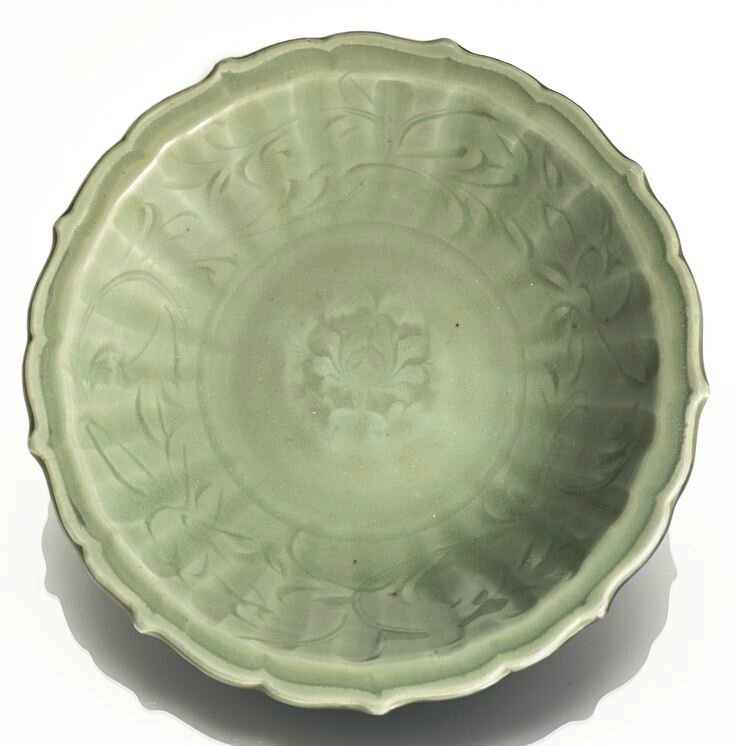 A 'Longquan' celadon barbed-rim 'Lotus' dish, Early Ming dynasty