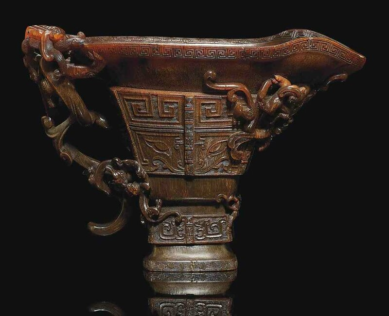 An impressive large archaistic rhinoceros horn 'Nine Dragons' libation cup, 17th century