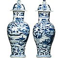 A pair of moulded blue and white baluster vases and covers,