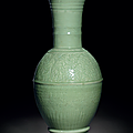 A rare massive carved Longquan celadon 'phoenix-tail' vase, Ming dynasty, 15th century