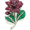A ruby, emerald and diamond flower brooch, by robert pouget