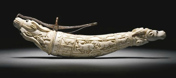 A Mughal ivory powder horn, India, 17th-18th century