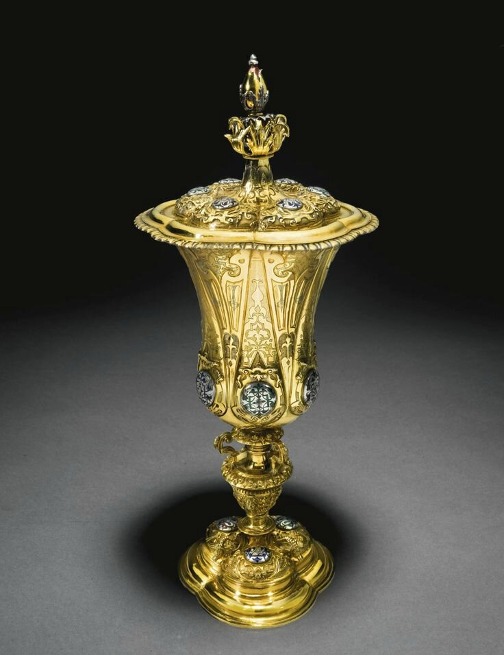 A German parcel-gilt silver and enamelled cup and cover, Caspar Widman, Nuremberg, 1559-70