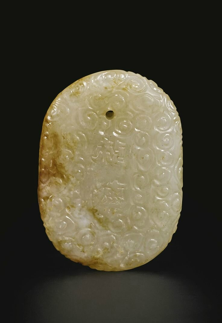 A white jade 'Dragon' plaque, Qing dynasty, 17th-18th century