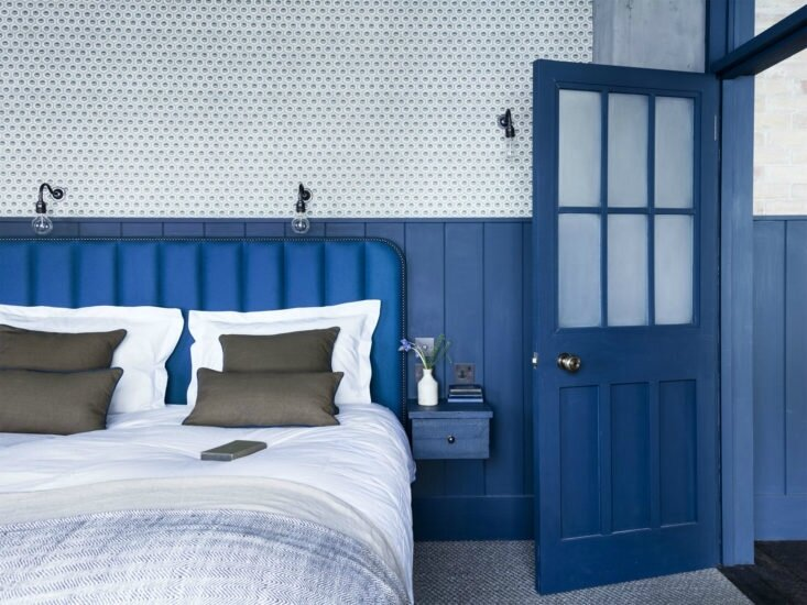Mark-Lewis-Interior-Design-Hoxton-Square-loft-blue-and-white-bedroom-tongue-and-groove-paneling-Rory-Gardener-photo-12-733x550