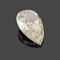 An unmonted champagne pear-shaped diamond weighing 10,13 cts