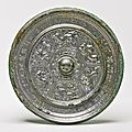 A bronze 'Mythical Beasts' mirror with inscription, Sui dynasty