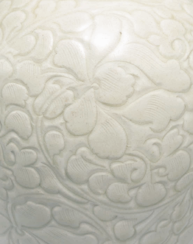A carved Qingbai 'Peony' meiping and cover, Southern Song Dynasty (1127-1279) detail 1