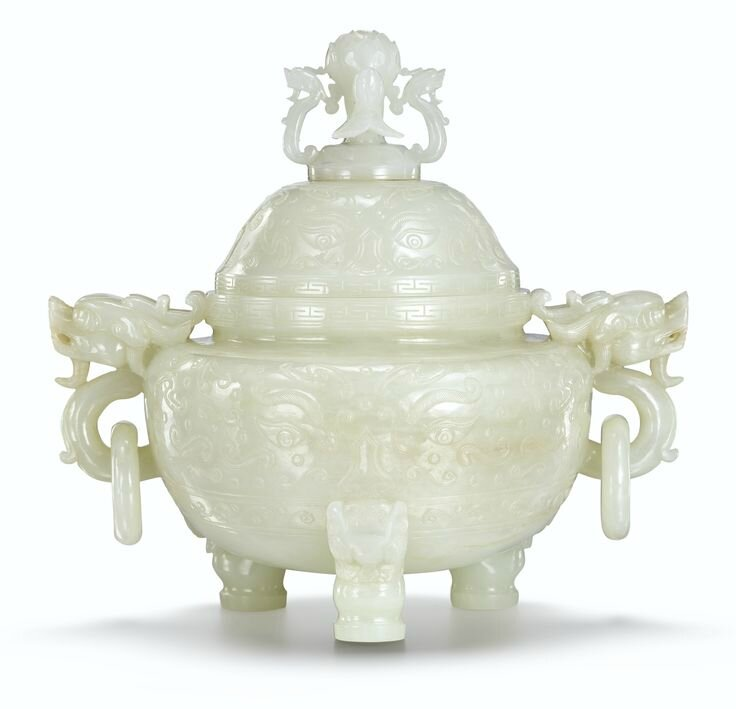 A large white jade tripod incense burner and cover, Qing dynasty, Qianlong period