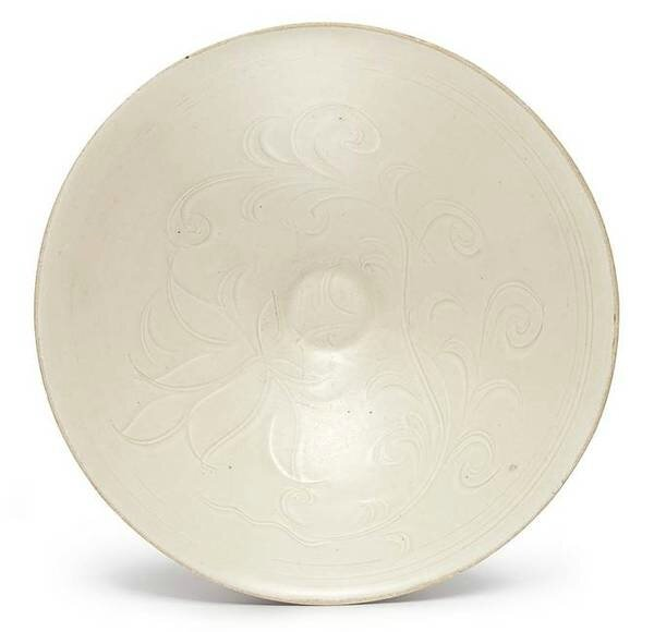 A carved 'Ding' white-glazed 'lotus' bowl, Song dynasty