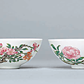 A pair of famille rose bowls; The porcelain Yongzheng six-character marks within double circles and of the period (1723-1735), the enamels later