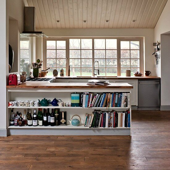 Open-plan-kitchen-with-peninsula-unit-and-reclaimed-flooring--Country-Homes-and-Interiors--Housetohome