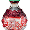 A red glass overlay 'Shou' character snuff bottle, Qing dynasty (1644-1911)