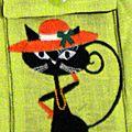 Chat chapeaute