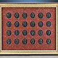 An important collection of 24 wedgwood and bentley basalt portrait medallions featuring the kings of england, circa 1775