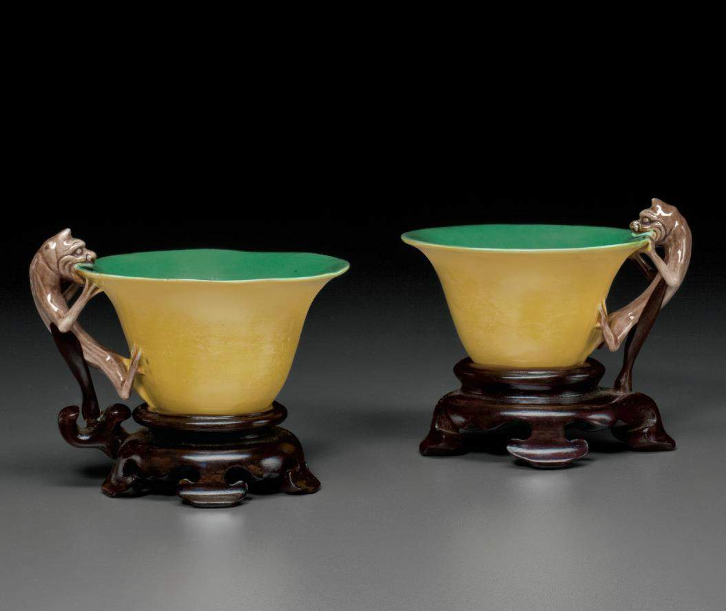 A rare pair of green, yellow and aubergine-glazed cups, Kangxi period (1662-1722)
