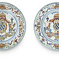 A rare pair of verte-imari armorial dishes for the portuguese market, early qianlong period (1736-1795)