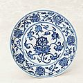 A very rare blue and white 'Eight Buddhist Emblems' dish, Chenghua six-character mark within double circles and of the period (1465-1487)