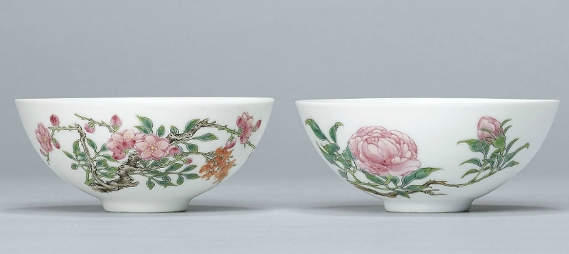 A pair of famille rose bowls; The porcelain Yongzheng six-character marks within double circles and of the period, the enamels l