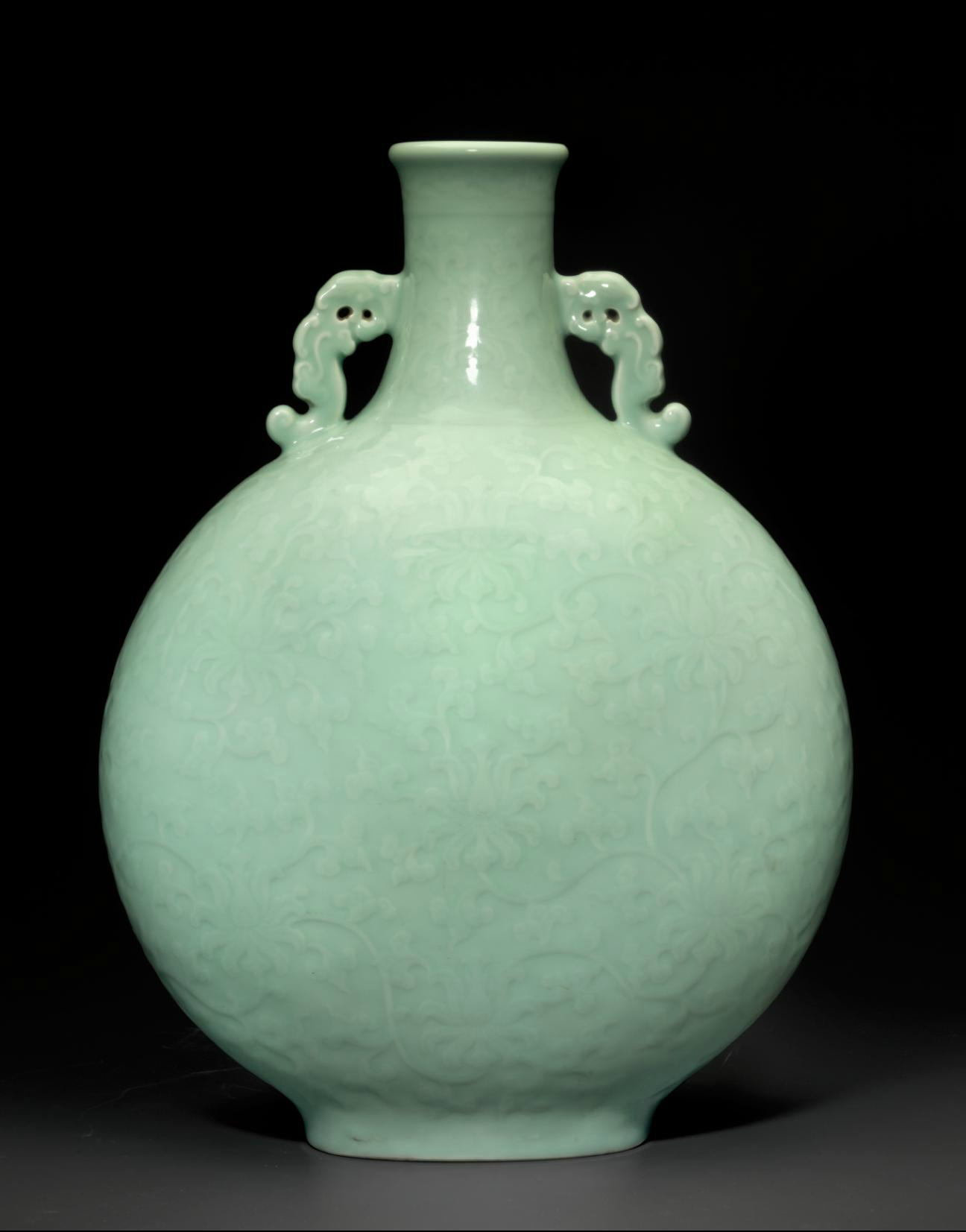 A magnificent and very rare large celadon-glazed carved moon flask, Qianlong six-character seal mark and of the period