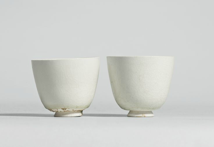 Two glazed white stoneware cups, Sui-Tang dynasty