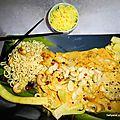 Filets de colin en sauce beurre de cacahuète/ coco accompagnés de nouilles + riz safrané