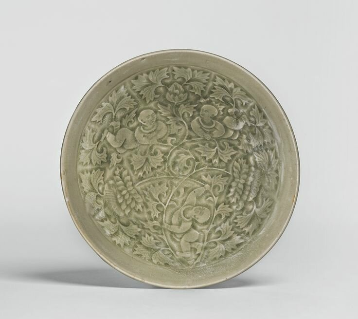 A 'Yaozhou' molded 'Boys' bowl, Northern Song - Jin dynasty