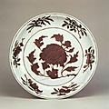 A large brown and white reserve-decorated 'peony' dish, Xuande mark and period © Jingdezhen Ceramics Archaeology Institut