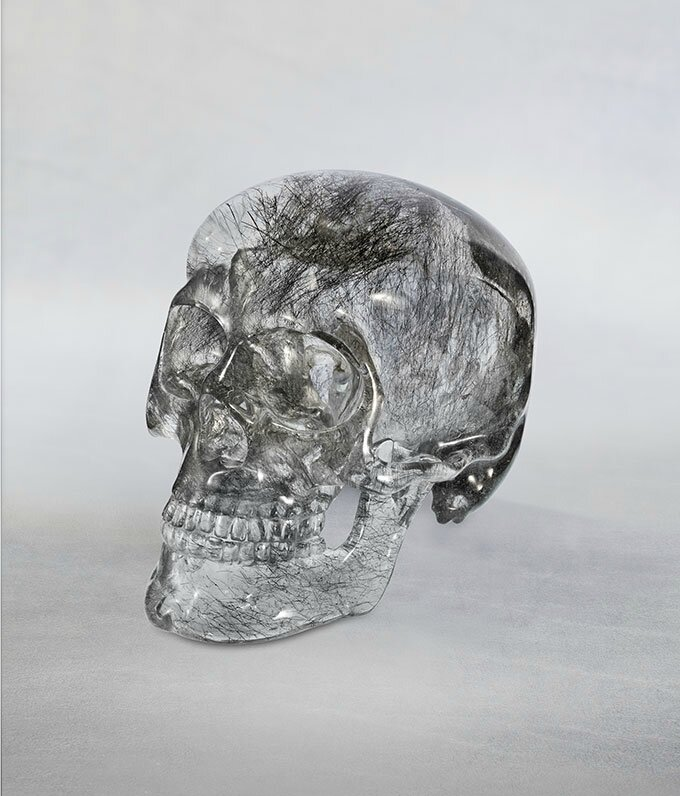 Harold Van Pelt. Quartz crystal skull. The crystal, originally weighing 250 lbs., contains rare izoklakeite inclusions.