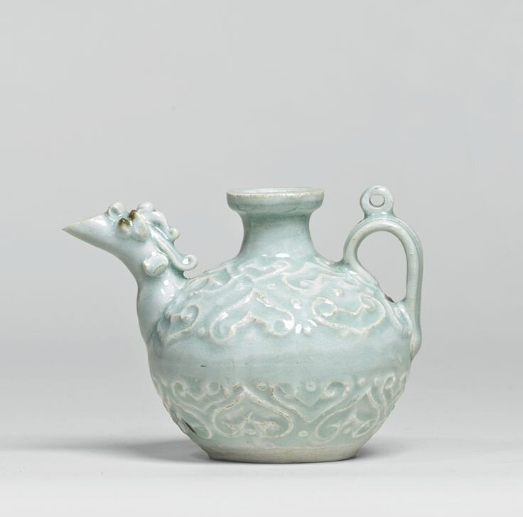 A rare 'Qingbai' carved ewer, Yuan dynasty