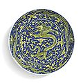 A fine blue-ground and yellow-enameled 'dragon' dish, kangxi mark and period (1662-1722)