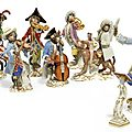 A meissen monkey-band, 20th century, blue crossed swords marks,pressnummernand incised numerals
