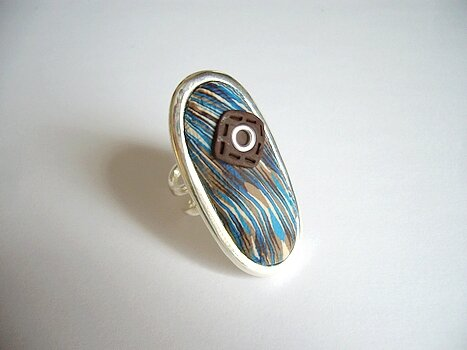couture bague ovale sertie