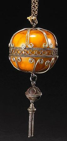 A_carved_amber_specimen_mounted_as_a_necklace