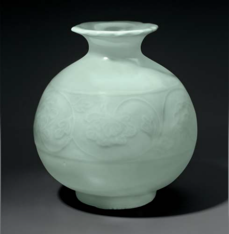 A celadon-glazed molded pomegranate-form vase, China or Japan, 19th-early 20th century