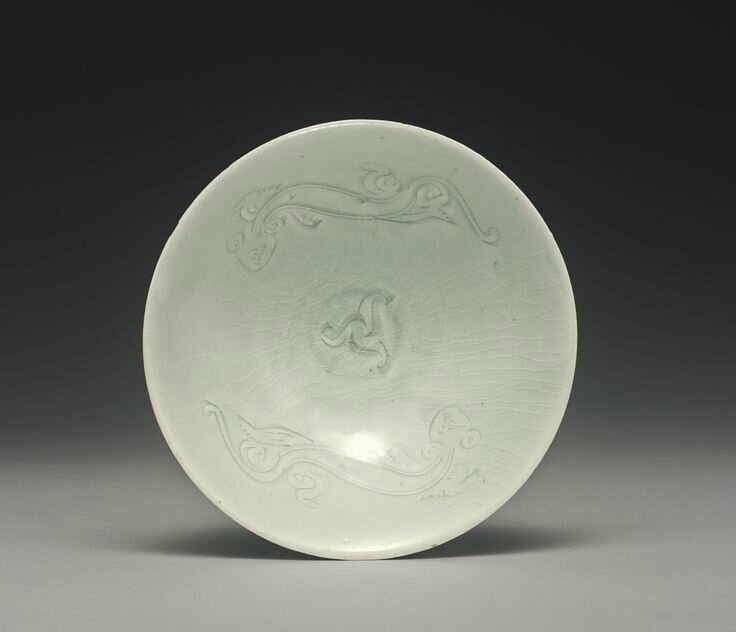 A carved 'Qingbai' 'chilong' bowl, Southern Song Dynasty
